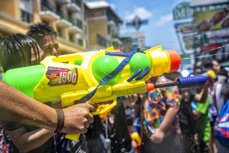 Bangkok, Thailand - April 13, 2018 : Water gun in water festival in Khao San Road, Let's play with soaked together on Songkran's day in Bangkok