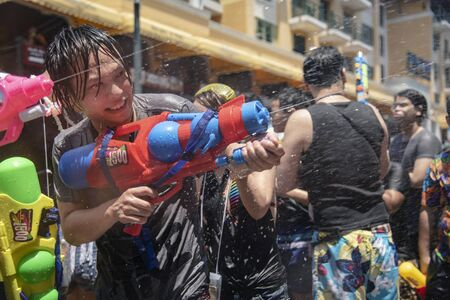 Bangkok, Thailand - April 13, 2018 : Tourist happiness fighting with water gun on the second day of water festival in Khao San Road, Let's play with soaked together Songkran's day in Bangkok