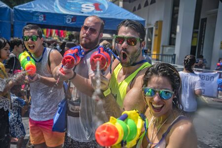 Bangkok, Thailand - April 13, 2018 : Tourists happiness fighting with water gun on the second day of water festival in Khao San Road, Let's play with soaked together on Songkran in  Bangkok Editorial