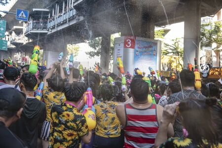 Bangkok, Thailand - April 13, 2018 : Tourists enjoying with splashing on the second day of water festival in Silom Road, Let's play with soaked together Songkran's day in Bangkok Editorial