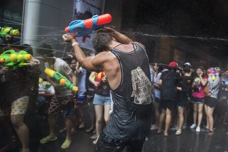 Bangkok, Thailand - April 14, 2017: Let's play with water gun was the splash water on each other in Songkran Festival at Silom Road