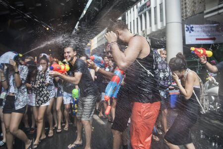 Bangkok, Thailand - April 14 2017: Let's play with water gun water gun was the plash water on each other in Songkran Festival at Silom Road