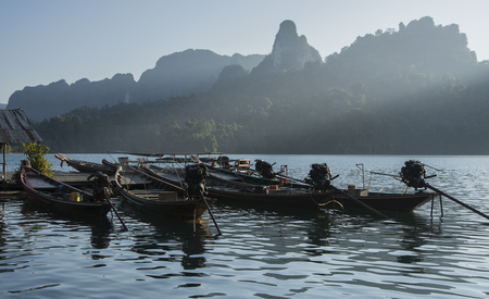 Beautiful Lake and ray of light on the mountain & the boats on the river at Khao Sok National Park Thailand. Stock Photo