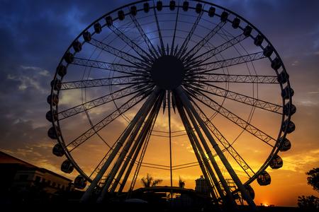 Silhouette of giant ferris wheel in Bangkok, Thailand Stock Photo