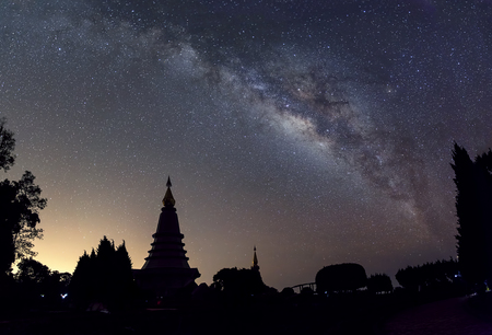 The starry night with the galaxy & silhouette of pagoda at Chiangmai Thailand
