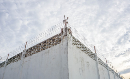 barbed wire fence: Prison wall