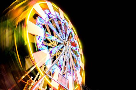 Ferris wheel rotates at night.