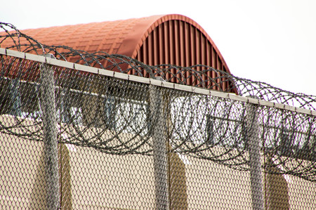 The barbed wire barrier to prevent the inmate of the prisoner.