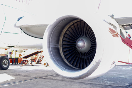 Plane on the airport Engine view Airport Background. Stock Photo