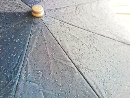 Rain umbrellas that are wet rain stains on the umbrella.