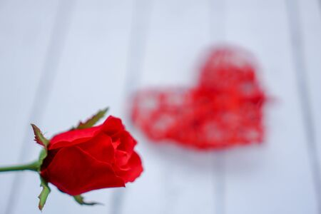 Red hearts and flowers on a white wood floor with space, ideas love or the day of love Valentines Day