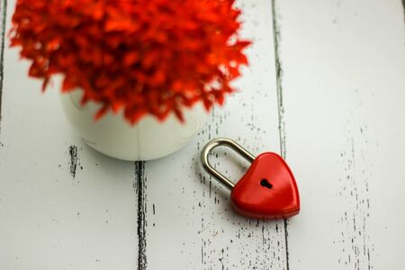 Red hearts and flowers on a white wood floor with space, ideas love or the day of love Valentines Day.