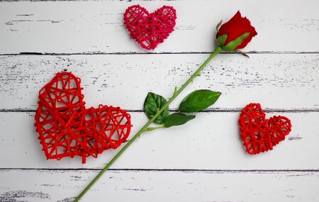 Red hearts and red flowers on white wood floors