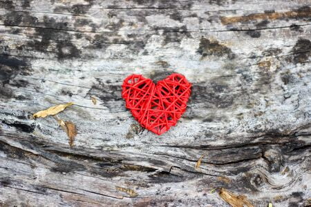Red heart on old wooden floor