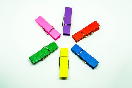 Many colorful Clothespin on a white background.