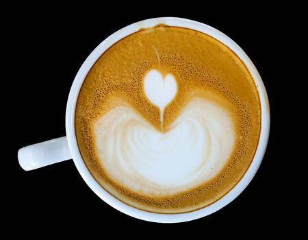 Heart-shaped coffee on a black background.