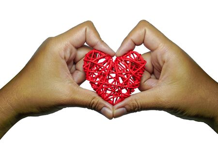 The red heart is on the hand, the idea of ​​giving love, forgiveness or Valentines Day. Banco de Imagens