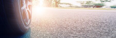 Banner size, Wheels on the road with morning light, concepts of business success Stockfoto