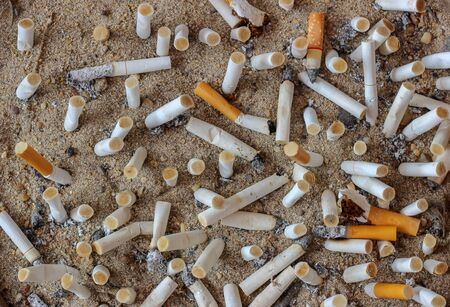 Filtered tobacco is discarded on the grounds of smoking cessation, the concept of quitting smoking.