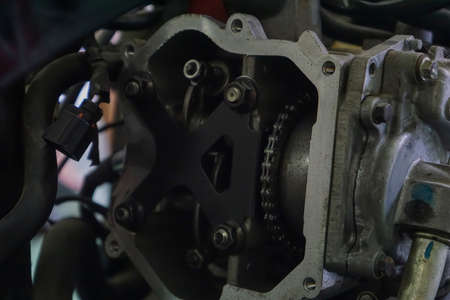 Part of the motorcycle engine on the table for repair in the workshop Stock fotó