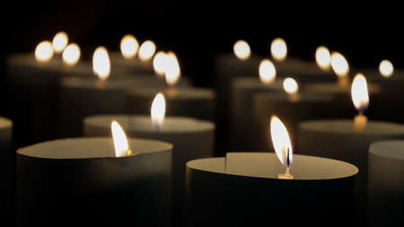 blurred background,Many burning candles have a shallow depth of field.