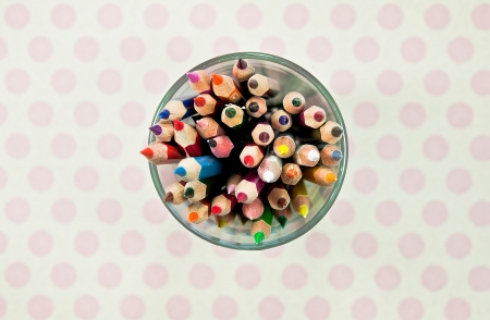 Cup with colorful wooden pencils photo