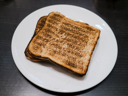 burnt toast: toast the toast was burnt  burnt toast at breakfast Stock Photo