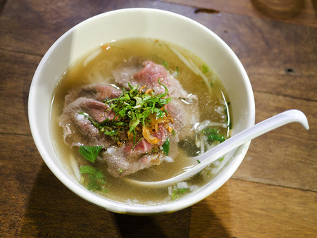 Pho bo , Vietnamese food , rice noodle soup with sliced rare beef  photo