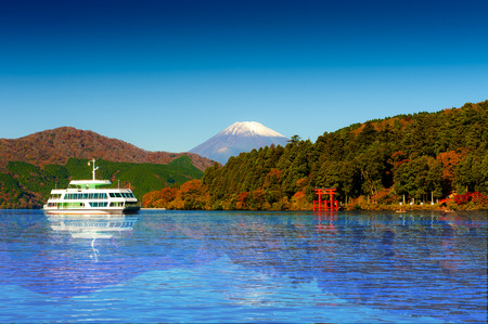 Red torii gate on the shore of Lake Ashi, near Mount Fuji in Hakone, Japan.