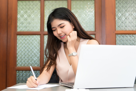 beautiful woman on the workplace using a digital tablet