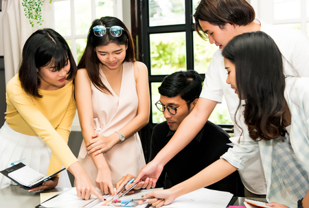 Group of friends are working together at co-working space