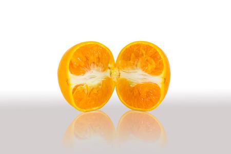 reflexive: Slice orange in half with reflexive shade Stock Photo