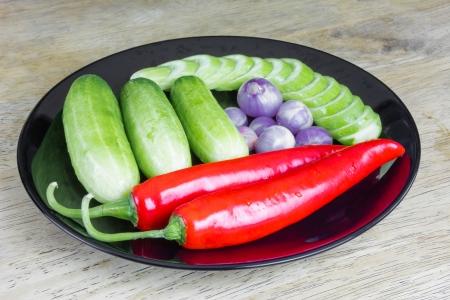alliaceae: Chilli peppers ,ascalonicum,Cucumbers in Black plate