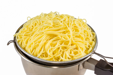 kitchen tool: egg noodles in colander kitchen tool Stock Photo