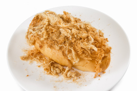 Bread with dried shredded pork isolated on dish photo