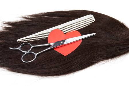 hair, heart shape and clippers on white background photo