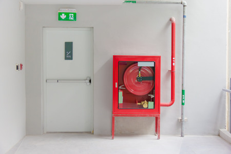 Fire exit door and fire extinguish equipment Stock Photo