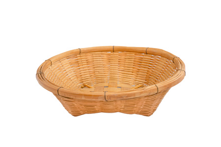 Empty wooden fruit basket on white background photo