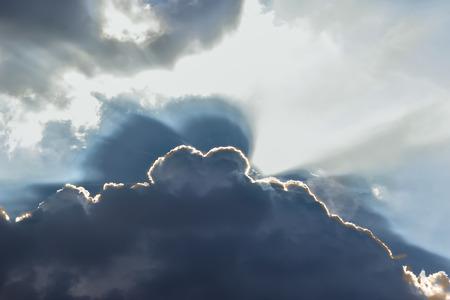 Ray of lights sunbeams break through thick clouds Standard-Bild