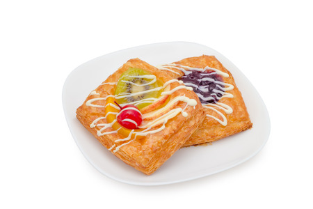 danish pastry with fruits on white background