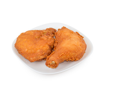 Fried chicken legs on white dish photo