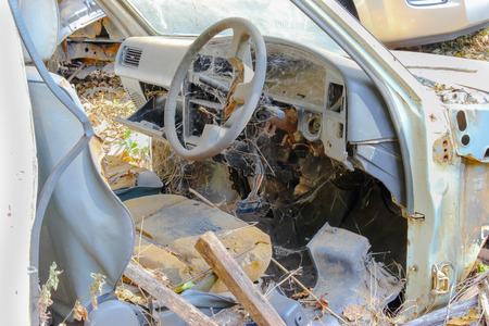 junkyard: car wreck at a junkyard