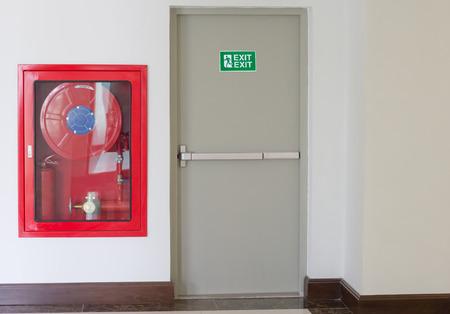Fire exit door and fire extinguish equipment Standard-Bild