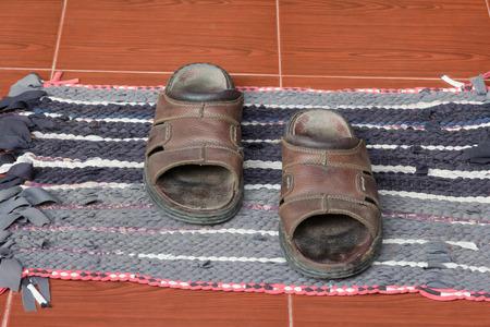doormat: Old sandals on doormat