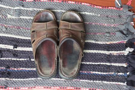 sandals: Old sandals on doormat