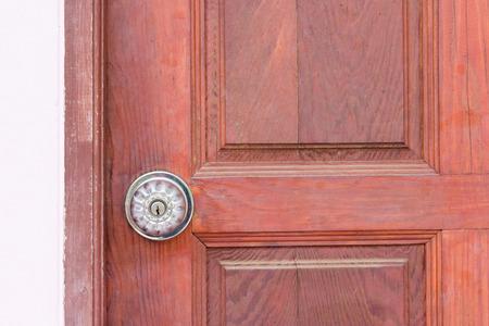 steel door: steel door knob on the wooden door Stock Photo