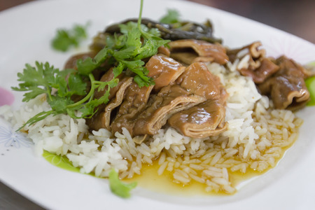 chitterlings: Close up Rice topped with Chitterlings stewed