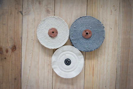 buffer: Cloth buffer wheel on the wooden background Stock Photo