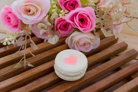 wood panel: Colorful French Macarons On wood panel Stock Photo