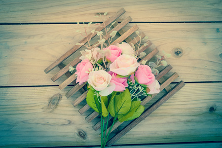 wood panel: rose bouquet on wood panel,vintage effect filter Stock Photo